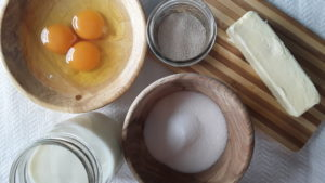 Fresh Eggs cracked, sugar, salt, milk, butter and yeast. Ingredients for homemade Braided Egg Bread